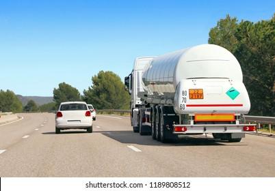 Tanker truck carrying dangerous goods on highway.