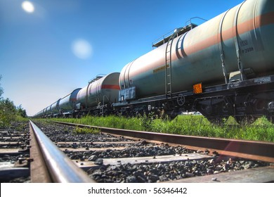Tanks with fuel being transported by rail, taken in backlit