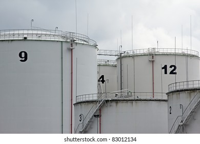 tanks in oil refinery factory on the cloudy sky