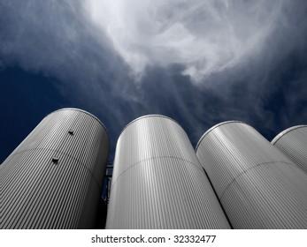 Tanks on sky background.