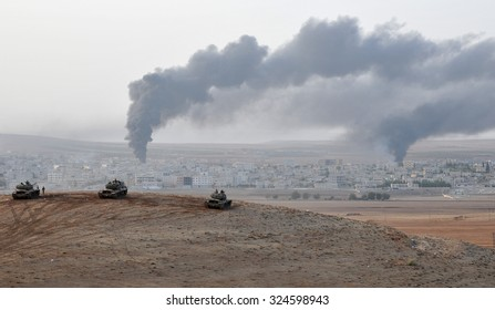 Tanks and soldiers of Turkish military waiting at Turkey - Syria border near source district in Sanliurfa, October 2014, Sanliurfa , Turkey