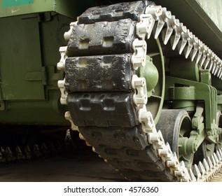 A tank's tread is shown.