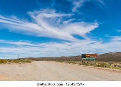 TANKWA KAROO NATIONAL PARK, SOUTH AFRICA, AUGUST 30, 2018: Turn-off from road R355 to the Tankwa Karoo National Park in the Northern Cape Province. Directional signs are visible