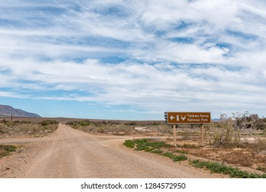 TANKWA KAROO NATIONAL PARK, SOUTH AFRICA, AUGUST 30, 2018: Directional sign at the turn-off to the reception office of the Tankwa Karoo National Park in the Northern Cape Province