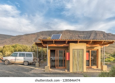 TANKWA KAROO NATIONAL PARK, SOUTH AFRICA, AUGUST 30, 2018: A camping site at Perdekloof in the Tankwa Karoo National Park. A vehicle is visible