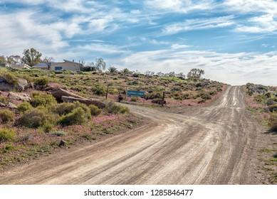 TANKWA KAROO NATIONAL PARK, SOUTH AFRICA, AUGUST 31, 2018: Entrance to the Gannaga Lodge in the Tankwa Karoo National Park of South Africa. Wildflowers are visible
