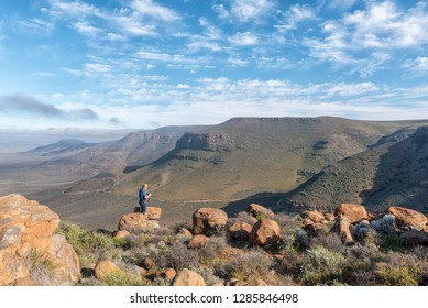 TANKWA KAROO NATIONAL PARK, SOUTH AFRICA, AUGUST 31, 2018: A tourist at the viewpoint in the Gannaga Pass in the Tankwa Karoo of South Africa