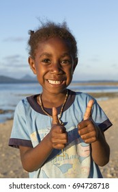 Tanna, Republic of Vanuatu, July 17th, 2014, Happy indigenous girl at the beach at sunset, EDITORIAL