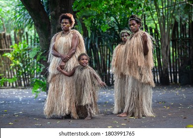 Tanna, Vanuatu - June 2019: group of  Melanesian local people in traditional indigenous straw clothes
