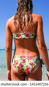 Tanned beautiful back of girl or woman with water drops from bathing in the sea. Suitable for Fitness, Wellness, Medicine, Sports, Health, Cosmetics, Body care.