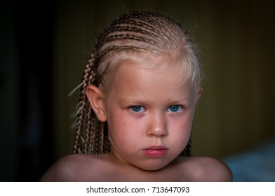 tanned European girl with African pigtails