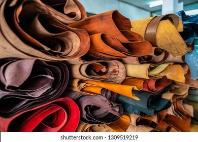 Tanned leather fold on shelf in craftsmanship market
