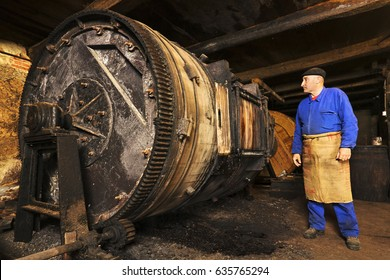 tanner  with old tools and machinery  in the antique mud tannery
