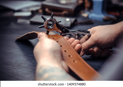 Tanner works as an artisan at the leather studio
