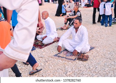 TANTA, EGYPT - JUNE 26, 2017: A man sitting on his praying mat, or 'Sajdah' in Arabic after Eid Fitri prayer. In Egypt, the Eid Prayer commonly be held at a big area like a stadium or football field.