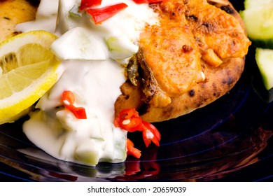 A tantalizing salmon tikka with fresh raita cucmber yogurt