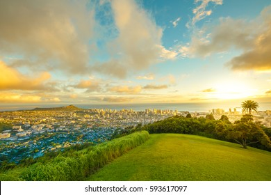 Tantalus Lookout at sunset, Puu Ualakaa State Park Honolulu. Tourists on panoramic city,Waikiki Beach and Diamond Head. Waikiki skyline Oahu Hawaii, United States. Vacation and travel concept.