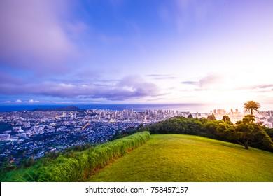 Tantalus Lookout at twilight, Puu Ualakaa State Park Honolulu. Tourists on panoramic city,Waikiki Beach and Diamond Head. Waikiki skyline Oahu Hawaii, United States. Vacation and travel concept.