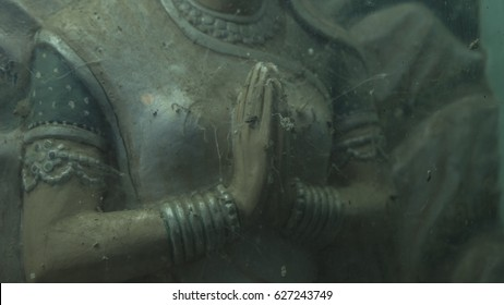 Tantra. Statue of Indian goddess in an ancient Hindu temple Under dusty glass. Cobweb in the Hands of an old Indian Statue, Namaste. Pravati Murty. Religious, Spiritual, Mystical Traditions of India. - Shutterstock ID 627243749