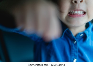 Tantrum and Aggressive little girl punch on camera.Mad kid got upset and sad and she has a negative attitude.Depressed little girl complaining.Attention deficit hyperactivity disorder (ADHD) Concept