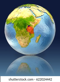 Tanzania on globe with reflection. Illustration with detailed planet surface. Elements of this image furnished by NASA.