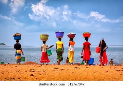 Tanzania, Tanganyika lake, January'28'12 .The women came to the laundry to the lake Tanganyika
