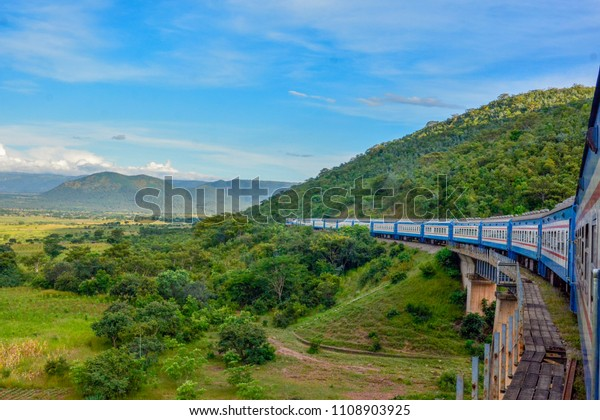 Tanzania Zambia Railways(TAZARA) Train going through tunnels and hills of Tanzania Mbeya Region. A high capacity train used by tourists and local commuters to travel in between Kapiri Mposhi and Dar.
