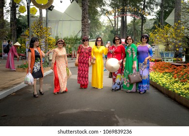 "Tao Dan Park, Ho Chi Minh City, Vietnam - February 15, 2018:  These women wear ""Ao dai"". ""Ao dai"" is traditional clothes of Viet Nam. They were welcome a New Year, in Hochiminh"