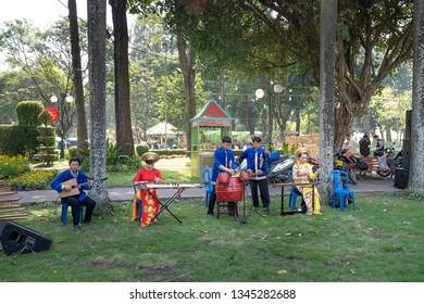 Tao Dan park, Hochiminh City, Vietnam - February 31, 2019: performing traditional musical instruments on the occasion of the Lunar New Year in 2019 at Tao Dan Park, Hochiminh City, Vietnam