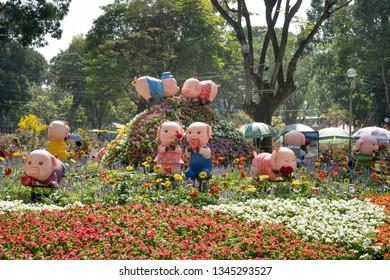 Tao Dan park, Hochiminh City, Vietnam - February 31, 2019: Ornate miniatures in Tao Dan park on the occasion of the year of the pig, the lunar year of the Pig