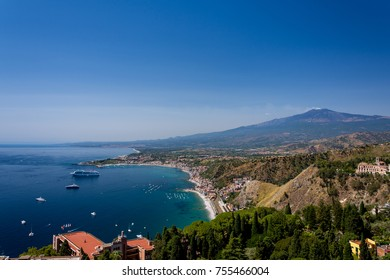 Taormina bay on a summer day with the Etna volcano in the background seen from the Greek theater of Taormina, Sicily, Italy