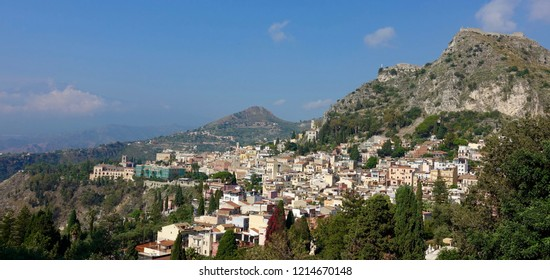 Taormina is a comune (municipality) in the Metropolitan City of Messina, on the east coast of the island of Sicily, Italy. It is on the Ionian Sea