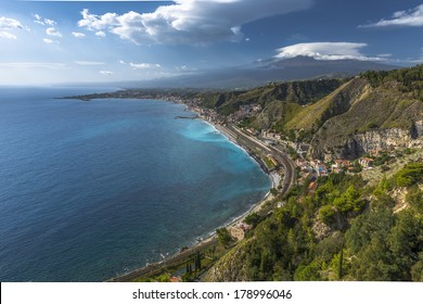 Taormina and Etna mountain, Sicily in a sunny summer  day with some clouds