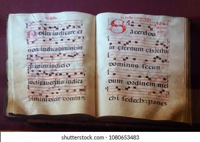 TAORMINA, ITALY- APR 18, 2018 - Illuminated manuscript in  the  Treasury of  St Paul's Cathedral, Taormina Sicily, Italy