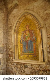 TAORMINA, ITALY- APR 18, 2018 - Mosaic of madonna and child in an outdoor shrine in Taormina Sicily, Italy