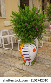 TAORMINA, ITALY- APR 18, 2018 - One-eyed face urns decorate the street of Taormina Sicily, Italy