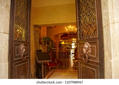 TAORMINA, ITALY- APR 18, 2018 - Lionhead door of luxury hotel in Taormina Sicily, Italy
