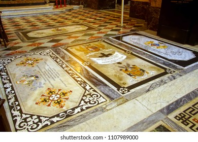 TAORMINA, ITALY- APR 18, 2018 - Tombstone of inlaid marble in floor of St Paul's Cathedral, Taormina Sicily, Italy