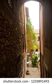 TAORMINA, ITALY- APR 18, 2018 - Restaurants tucked away on narrow stepped street in Taormina Sicily, Italy