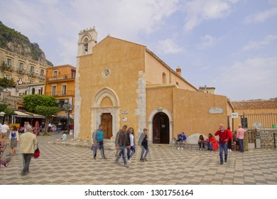 TAORMINA, ITALY- APR 18, 2018 - Tourists in front of church in Taormina Sicily, Italy