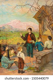 TAORMINA, ITALY - APRIL 9, 2018: The  by St. Don Bosco among the children in church Chiesa di San Guseppe from 20. cent.