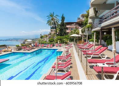 TAORMINA, ITALY - MAY 17, 2016: Swimming pool of a four star hotel in Taormina with a beautiful view at the Sicilian coast