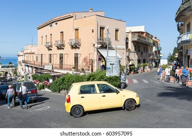 TAORMINA, ITALY - MAY 17, 2016: Busy centre with tourists and cars of Taormina at the island Sicily