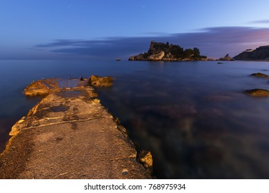 Taormina, Sicily: Isola Bella (Beautiful Island) seen at twilight; very long exposure.