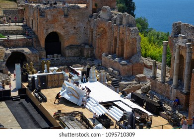 Taormina, Sicily, Italy - August 18, 2017: Preparing of ancient Greek theater for Aida Performance. Aida is an opera in four acts by Giuseppe Verdi.