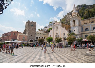 Taormina, Sicily, Italy - August 21, 2017: Tourists visit Piazza 9 Aprile - famous town square with many shops and restaurants