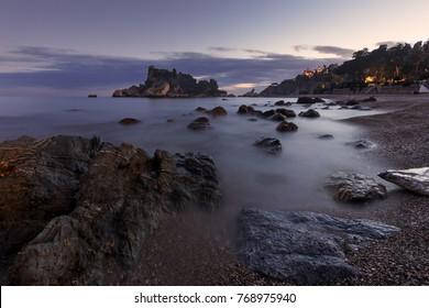 Taormina (Sicily, Italy): famous Isola Bella at dusk; long exposure.