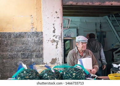 TAORMINA SICILY ITALY ON OCTOBER 2018: Fish shop Ortygia (Siracusa), Sicily: Outdoor Market Stalls and Shoppers on October 13, 2018