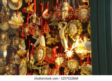 TAORMINA, SICILY - NOV 29, 2018 - Souvenirs with the three legged Medusa symbol of Sicily, Taormina, Sicily, Italy