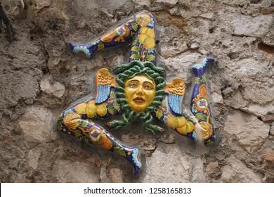 TAORMINA, SICILY - NOV 29, 2018 - Porcelain with the three legged Medusa symbol of Sicily, Taormina, Sicily, Italy